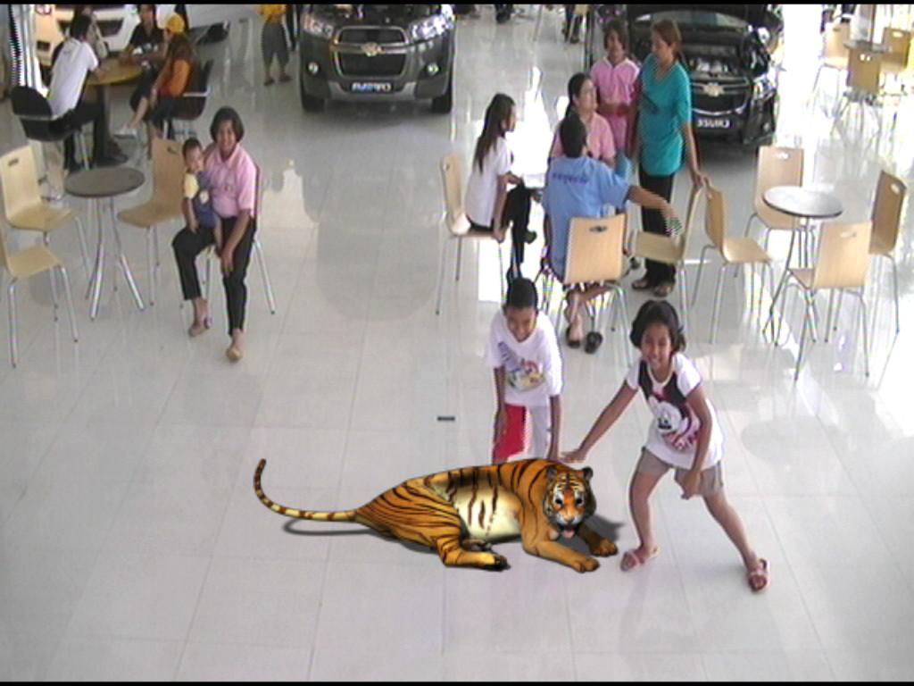 A 3D Tiger appears and sits down in front of the audience.